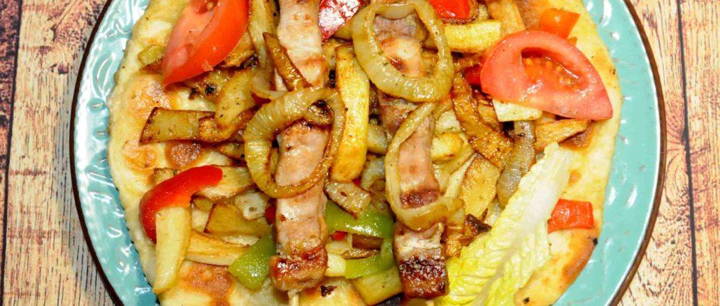 Χοιρινό με πατάτες και πίτα